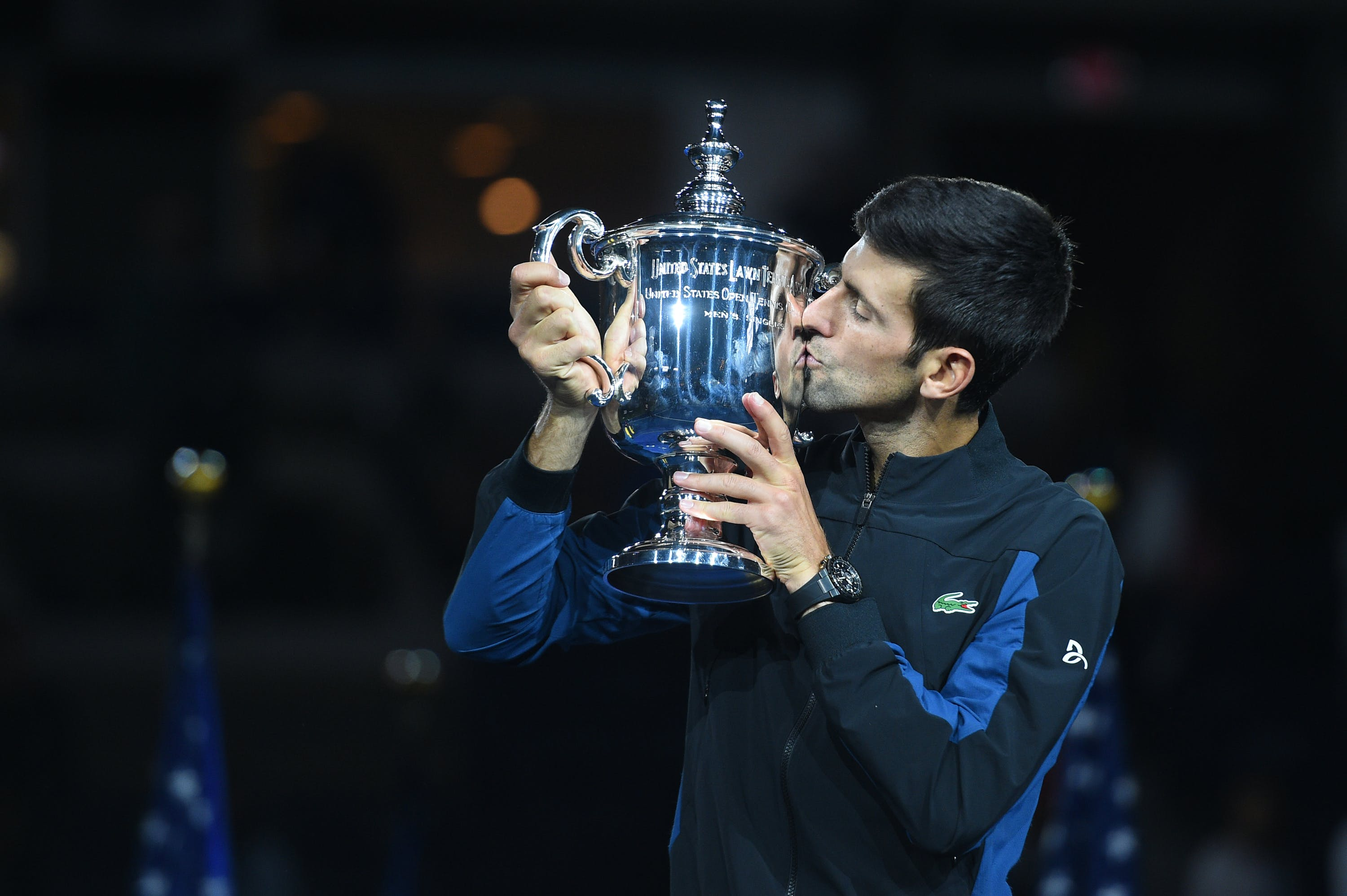 Novak Djokovic kisses the 2018 US Open trophy