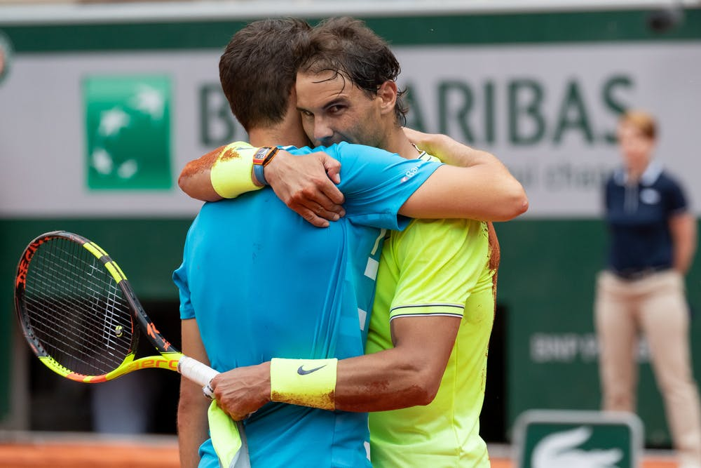 Rafael Nadal and Dominic Thiem holding after match point at 2019 Roland-Garros