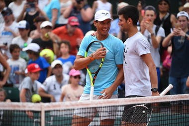 Rafael Nadal and Novak Djokovic laughing during Roland-Garros 2019