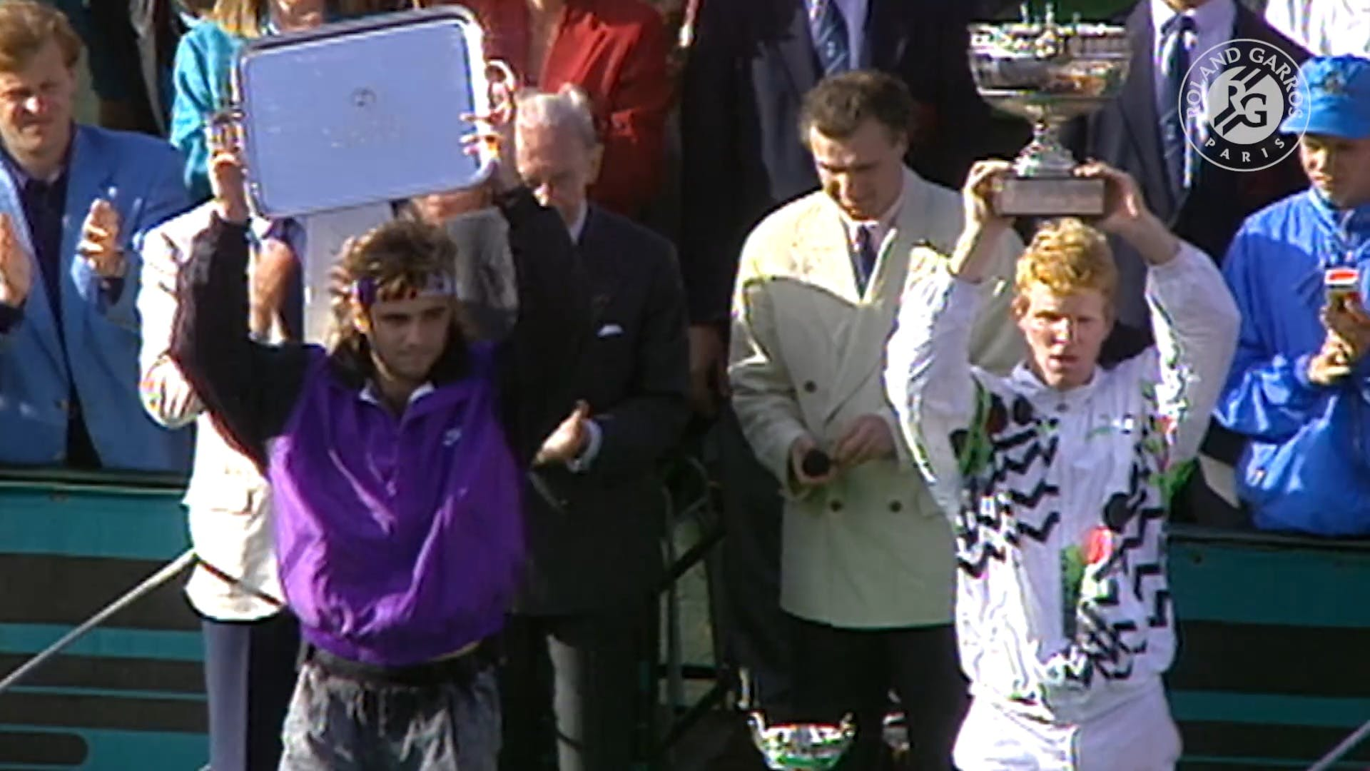 Andre Agassi and Jim Courier during the trophy ceremony at Roland-Garros 1991
