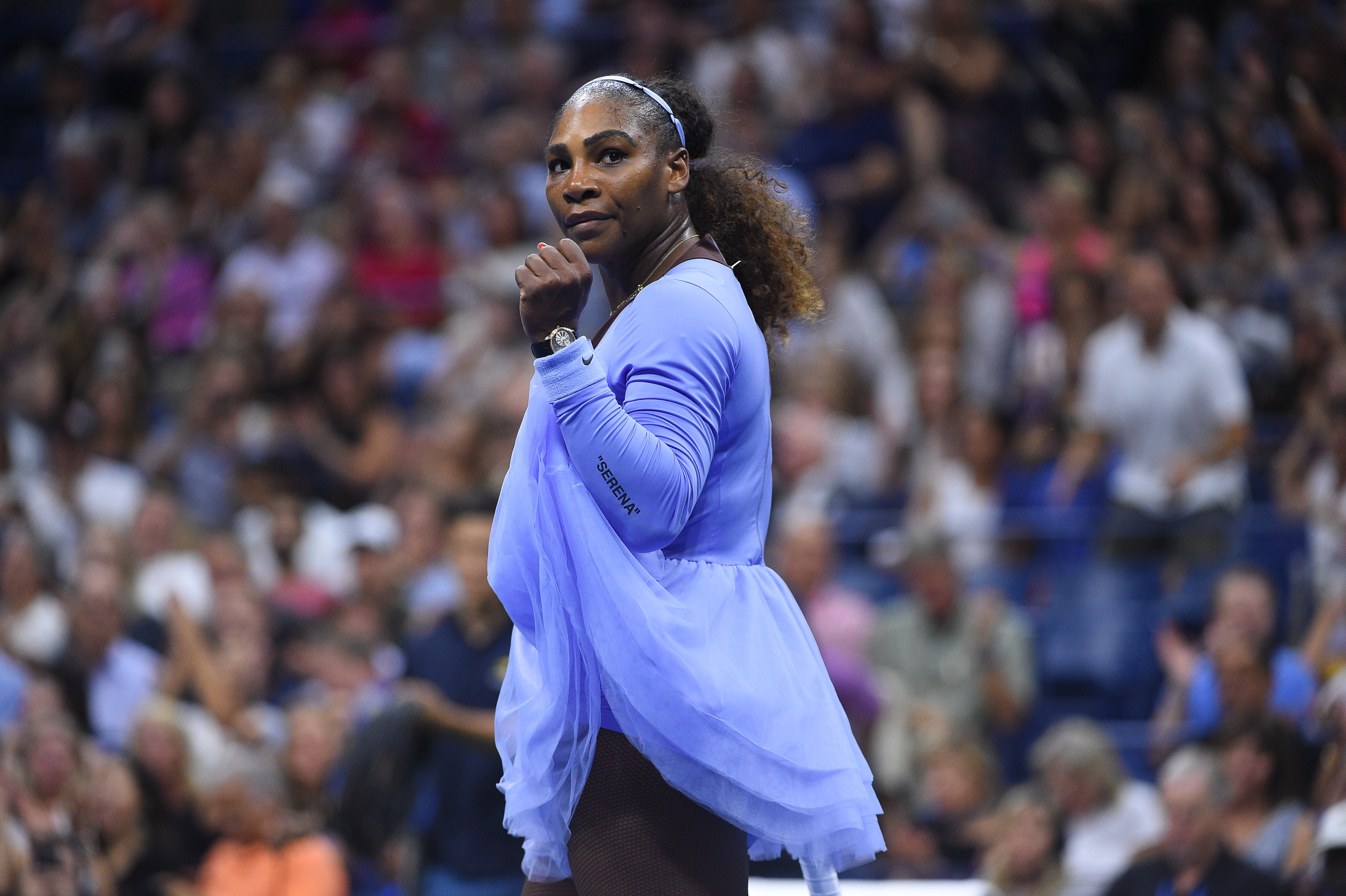 Serena Williams looking to her bow at the end of her semifinal match at the US Open 2018