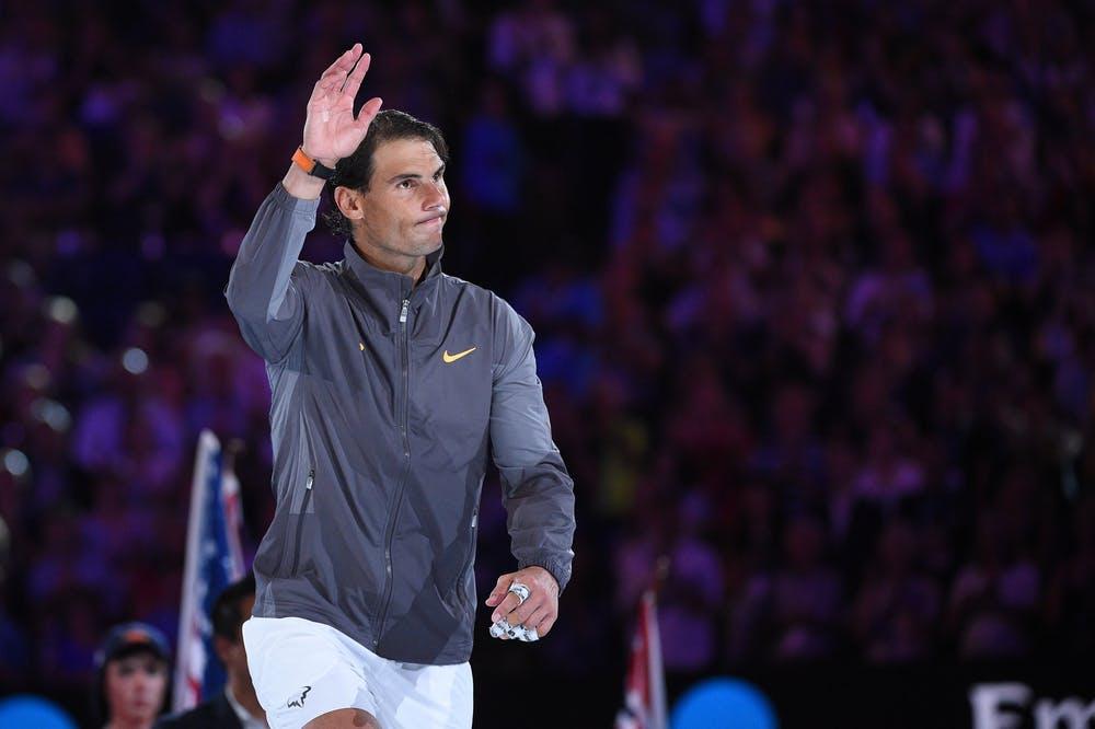 Rafael Nadal glimbing on the podium at the Australian Open 2019
