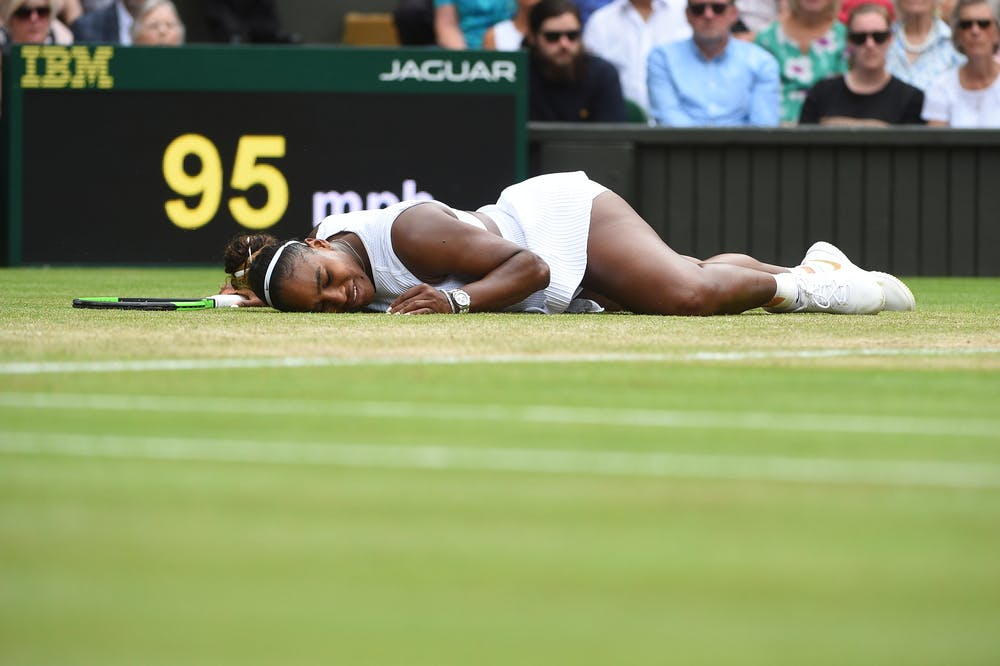 Serena Williams lyong on the grass at Wimbledon 2019