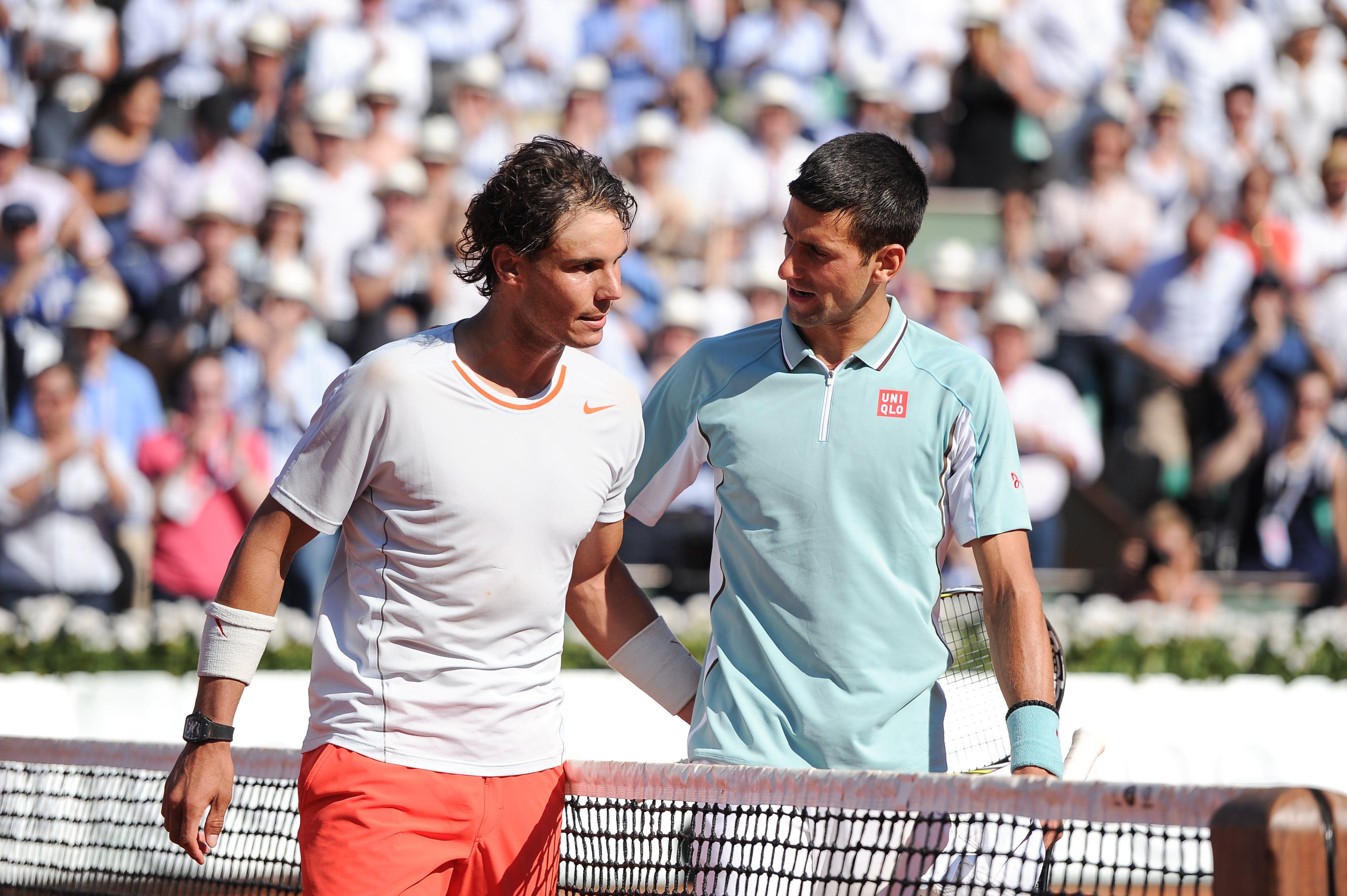 Rafael Nadal & Novak Djokovic after their semi-final at Roland-Garros 2013