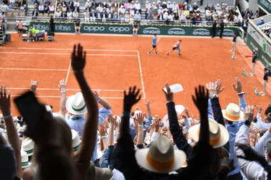 Crowd waving on the Court Philippe-Cahtrier during Roland-Garros 2019