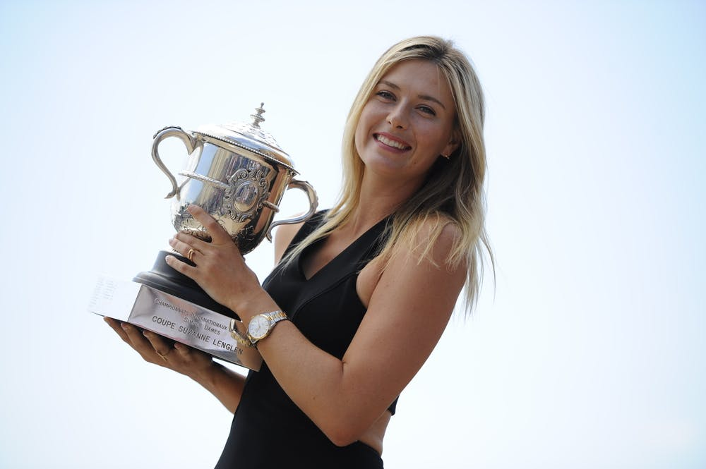 Maria Sharapova posing with the 2014 Roland-Garros trophy in Paris