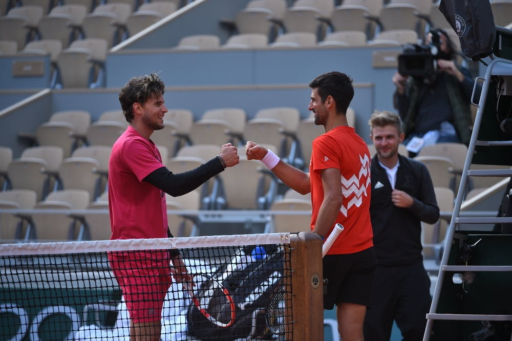 Dominic Thiem and Novak Djokovic at the net after a practice at Roland-Garros 2020