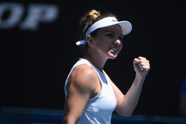 Simona Halep smiling and fist pumping at the 2020 Australian Open