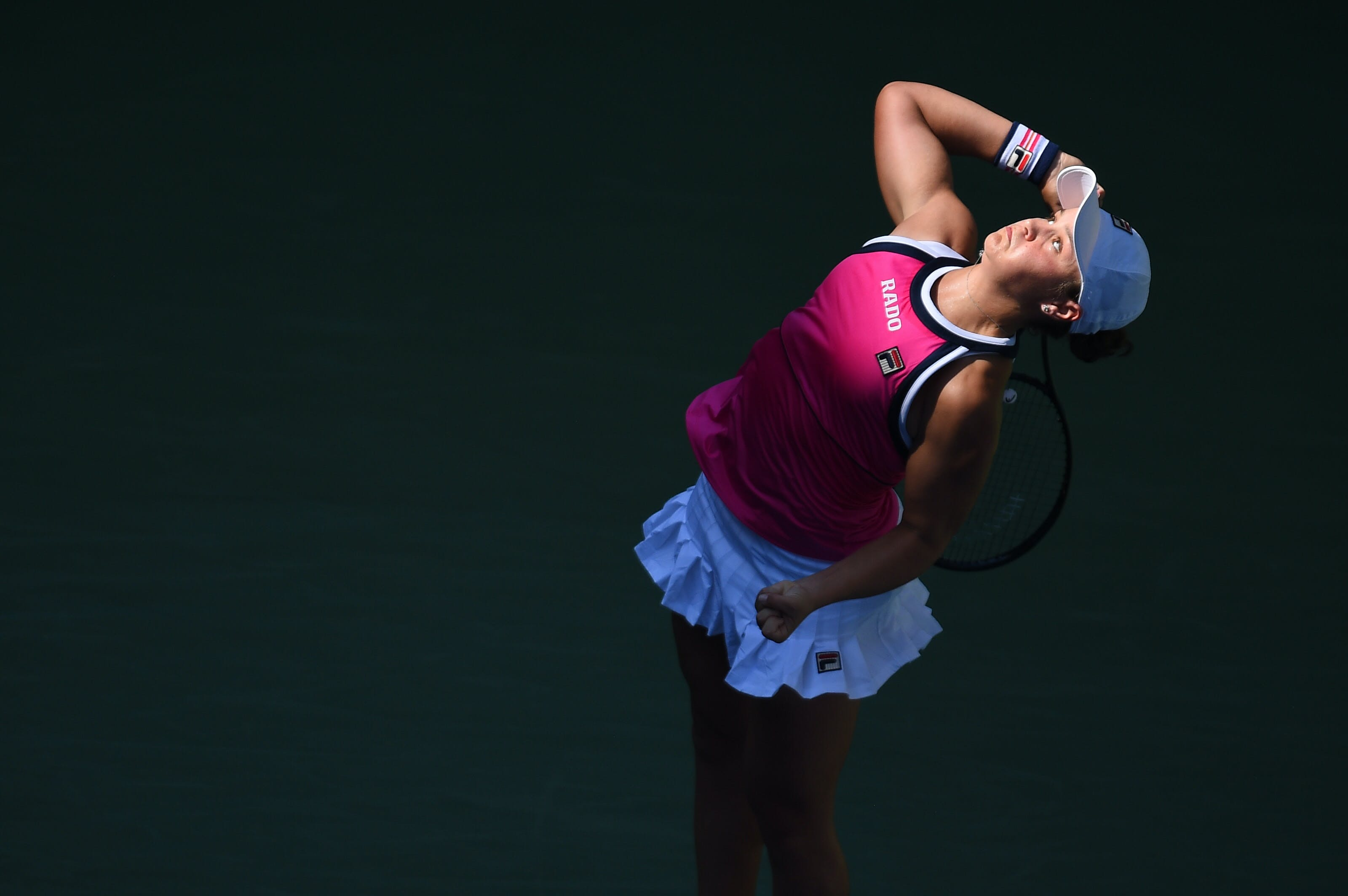 Ashleigh Barty serving in the light during her third round match at the 2019 US Open