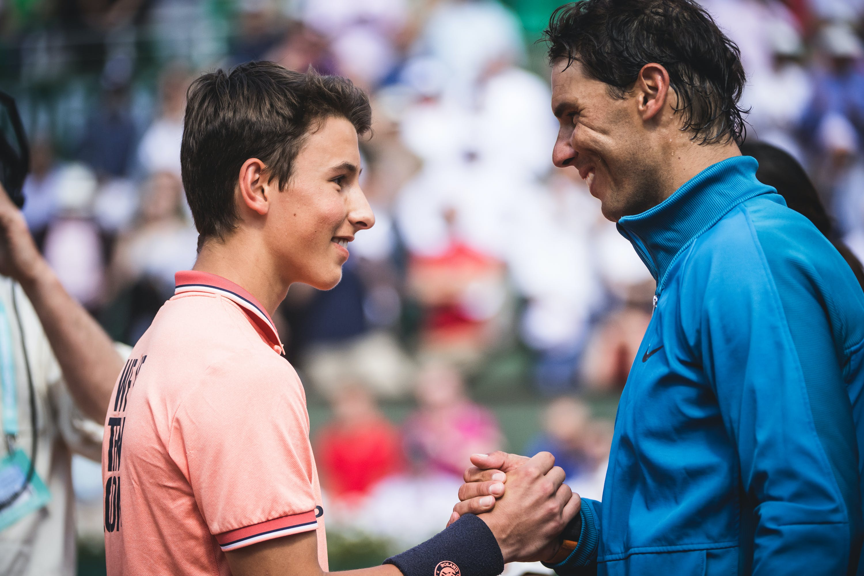 Rafael Nadal smiling and chatting with a Roland-Garros ballkid at RG18.