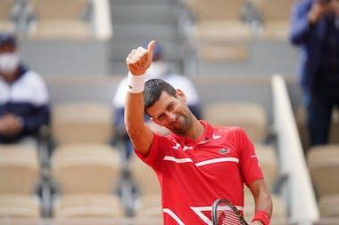 Novak Djokovic smiling and blinking during Roland-Garros 2020.