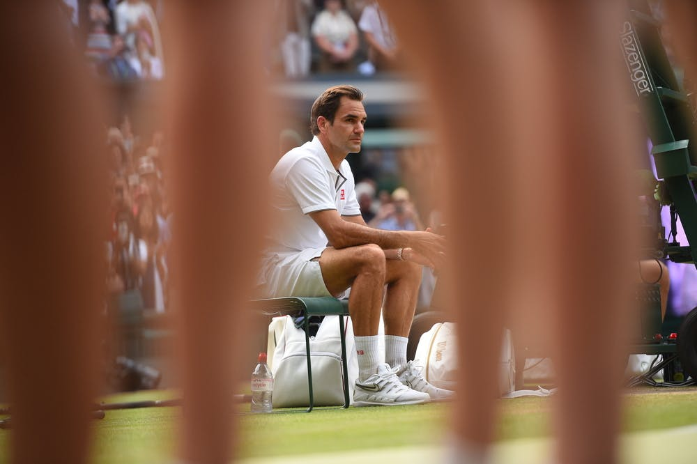 A sad Roger Federer sitting during the trophy presentation at Wimbledon 2019