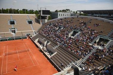 Fans watch Rafael Nadal practice on Court Suzanne-Lenglen.