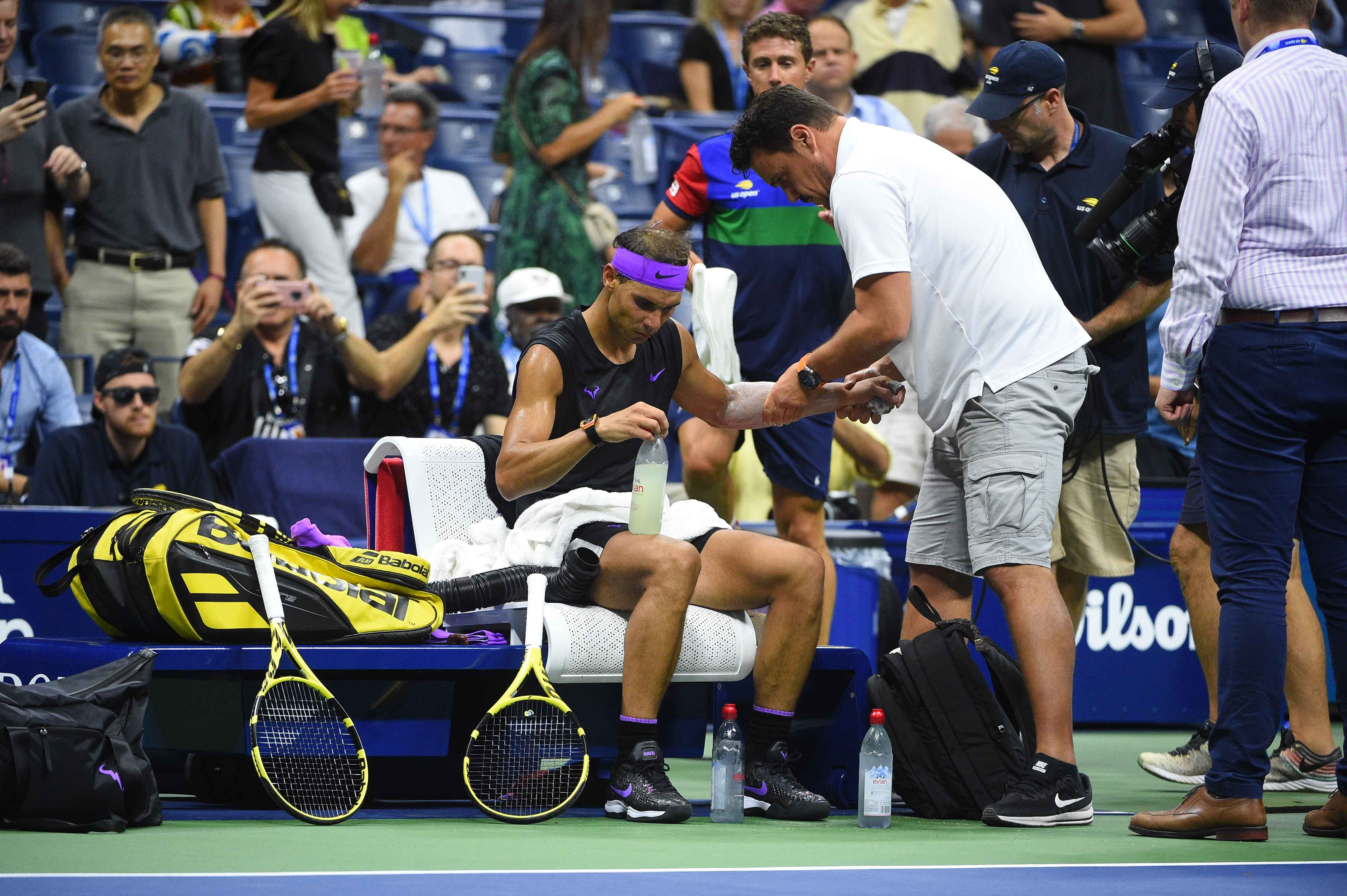 Rafael Nadal getting on court treatment during his quarterfinal at the 2019 US Open