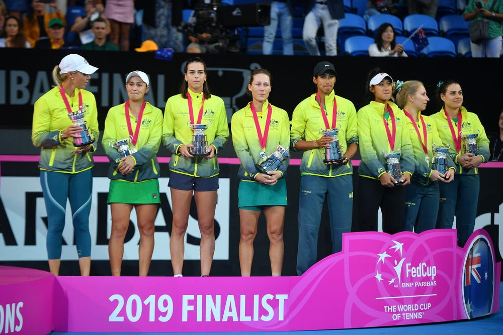 Ashleigh Barty crying in the middle of the Australian team at the 2019 Fed Cup final