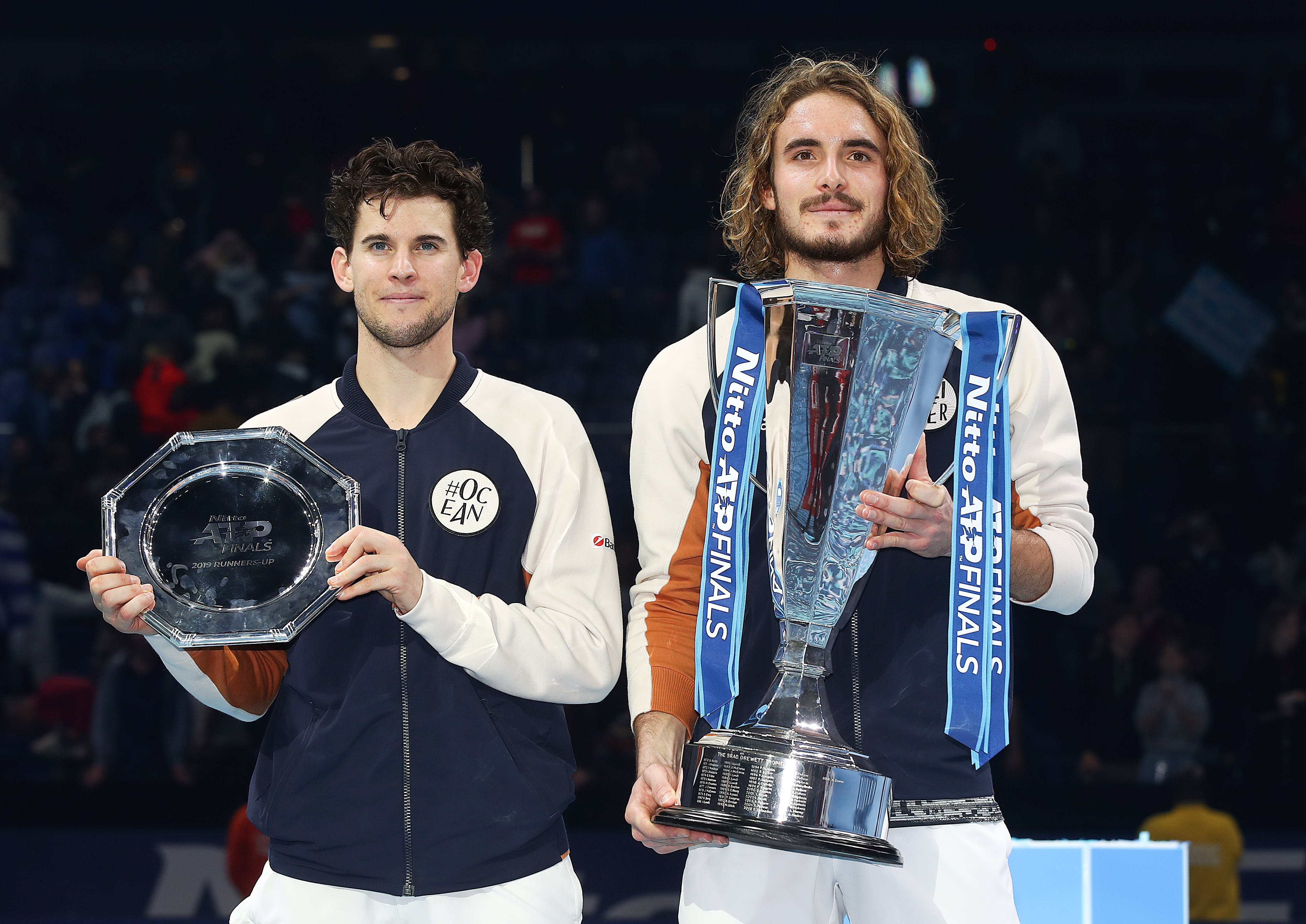 Stefanos Tsitsipas and Dominic Thiem posing with their trophies at the ATP Finals 2019