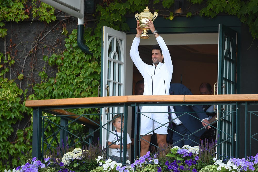 Novak Djokovic presenting the Wimbledon 2019 trophy to the crowd