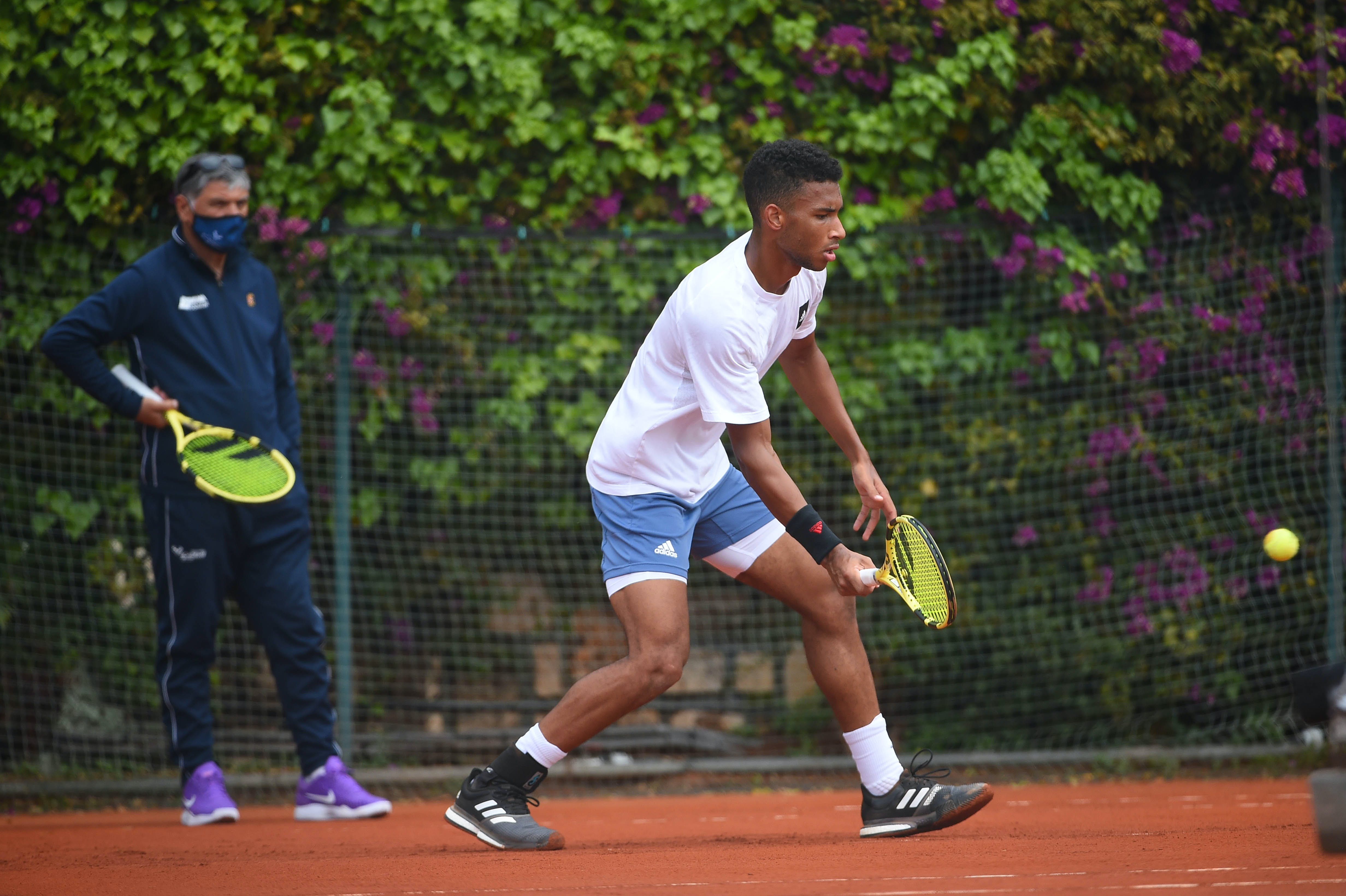 Toni Nadal coaching Felix Auger-Aliassime during practice at Rolex Monte-Carlo Masters 2021