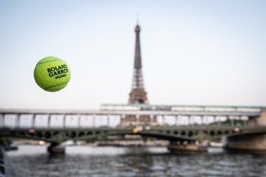 The 2020 Roland-Garros tennis ball in front of the Eiffel Tower