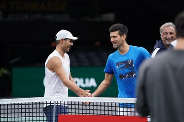 Rafael Nadal and Novak Djokovic joking at practice during the Rolex Paris Masters 2019