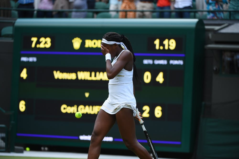 The scoreboard of the first round match between Cori Gauff and Venus Williams during Wimbledon 2019