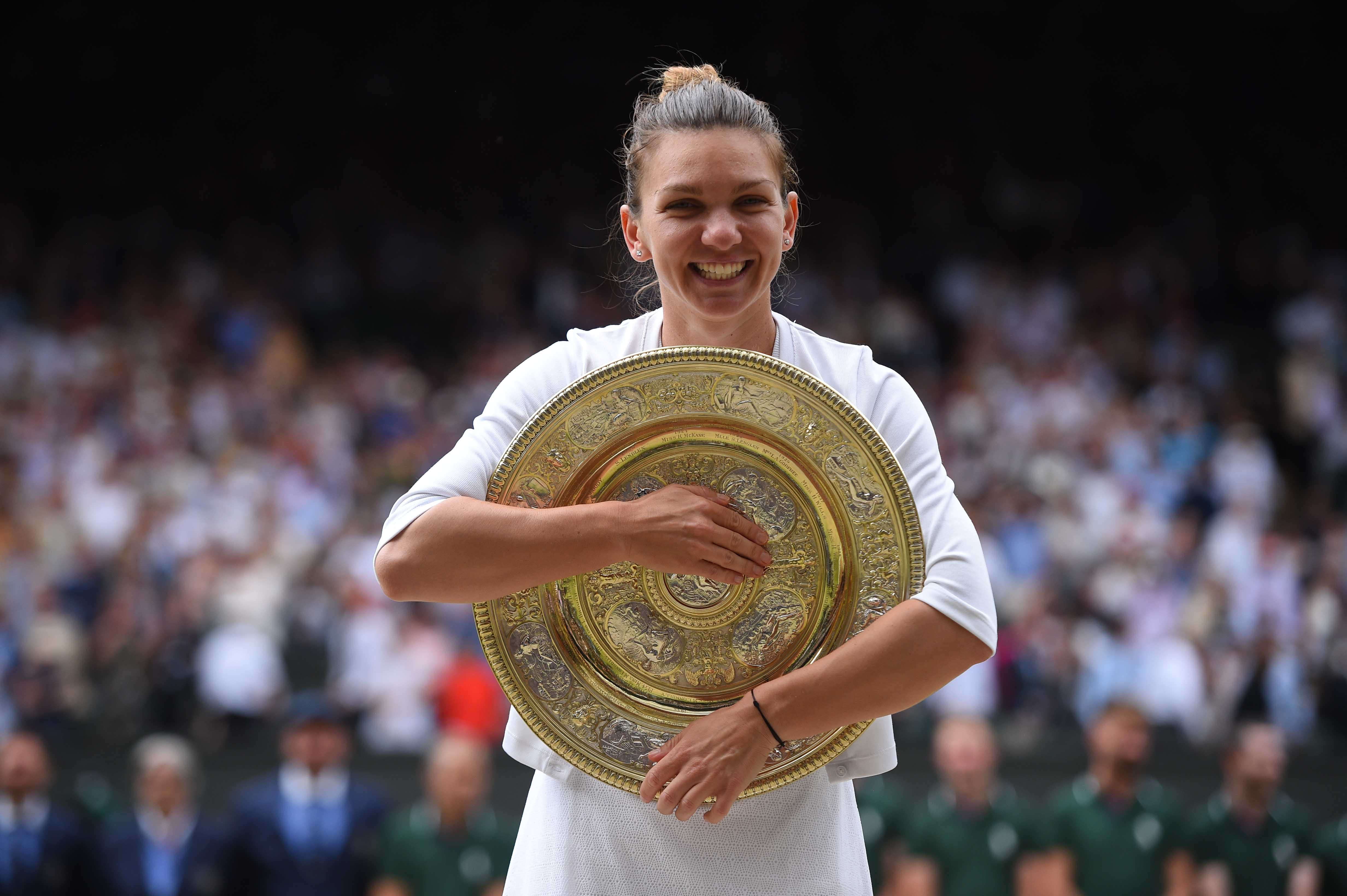 Simona Halep smiling with her Wimbledon 2019 trophy