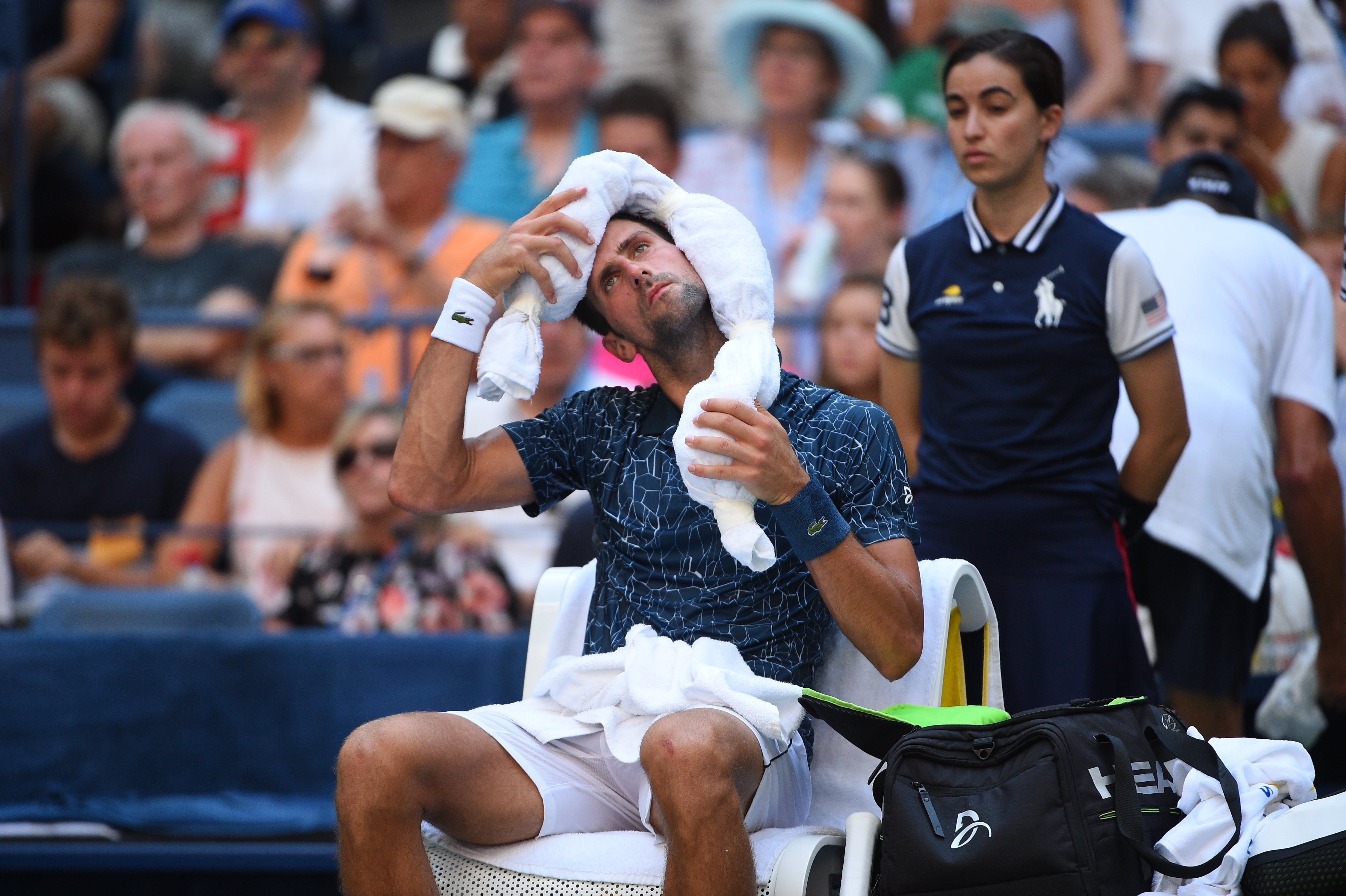 Novak Djokovic and his ice towel at the US Open 2018