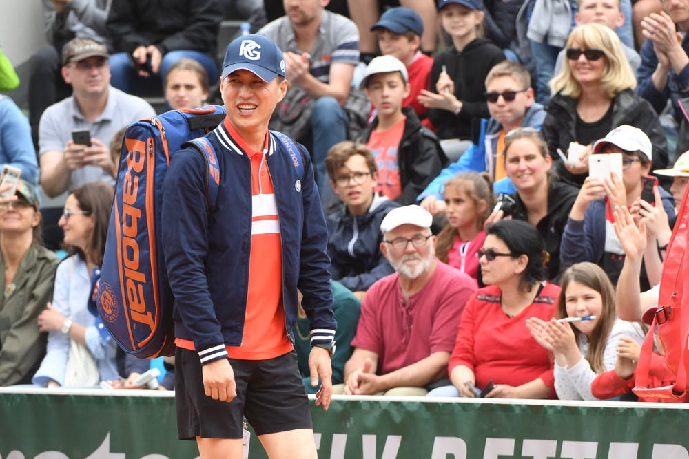 Jin Dong smiling at Roland-Garros 2019