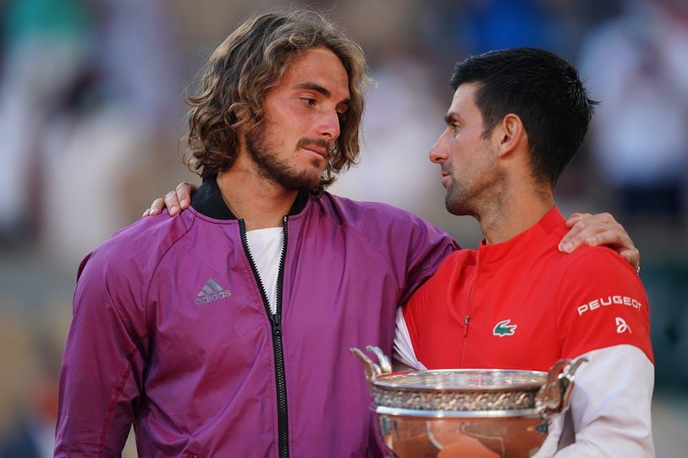 Stefanos Tsitsipas and Novak Djokovic chatting during the trophy presentation at Roland-Garros 2021