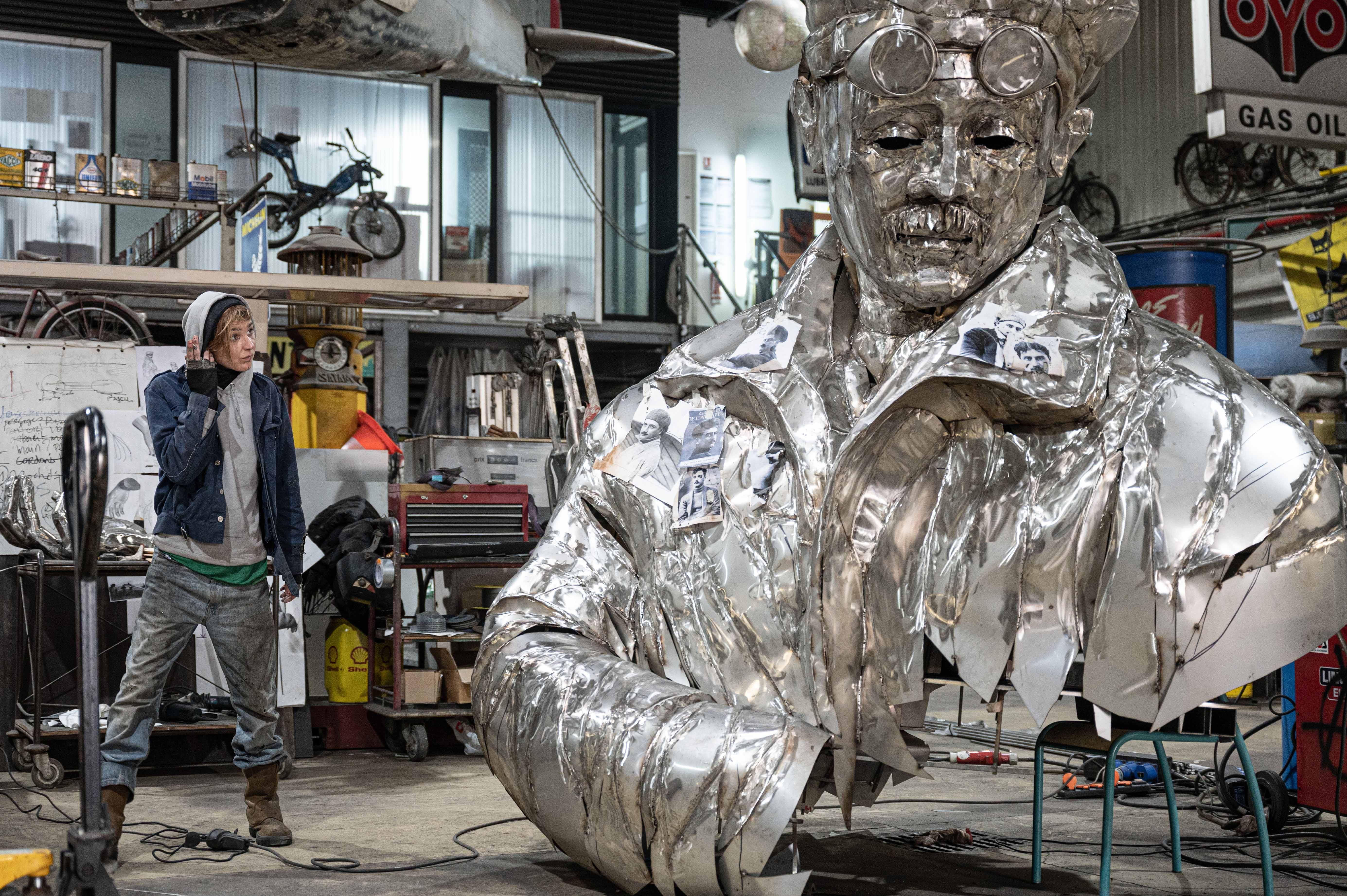 Caroline Brisset in her studio in Marseille in front of her monumental sculpture of the aviator Roland Garros