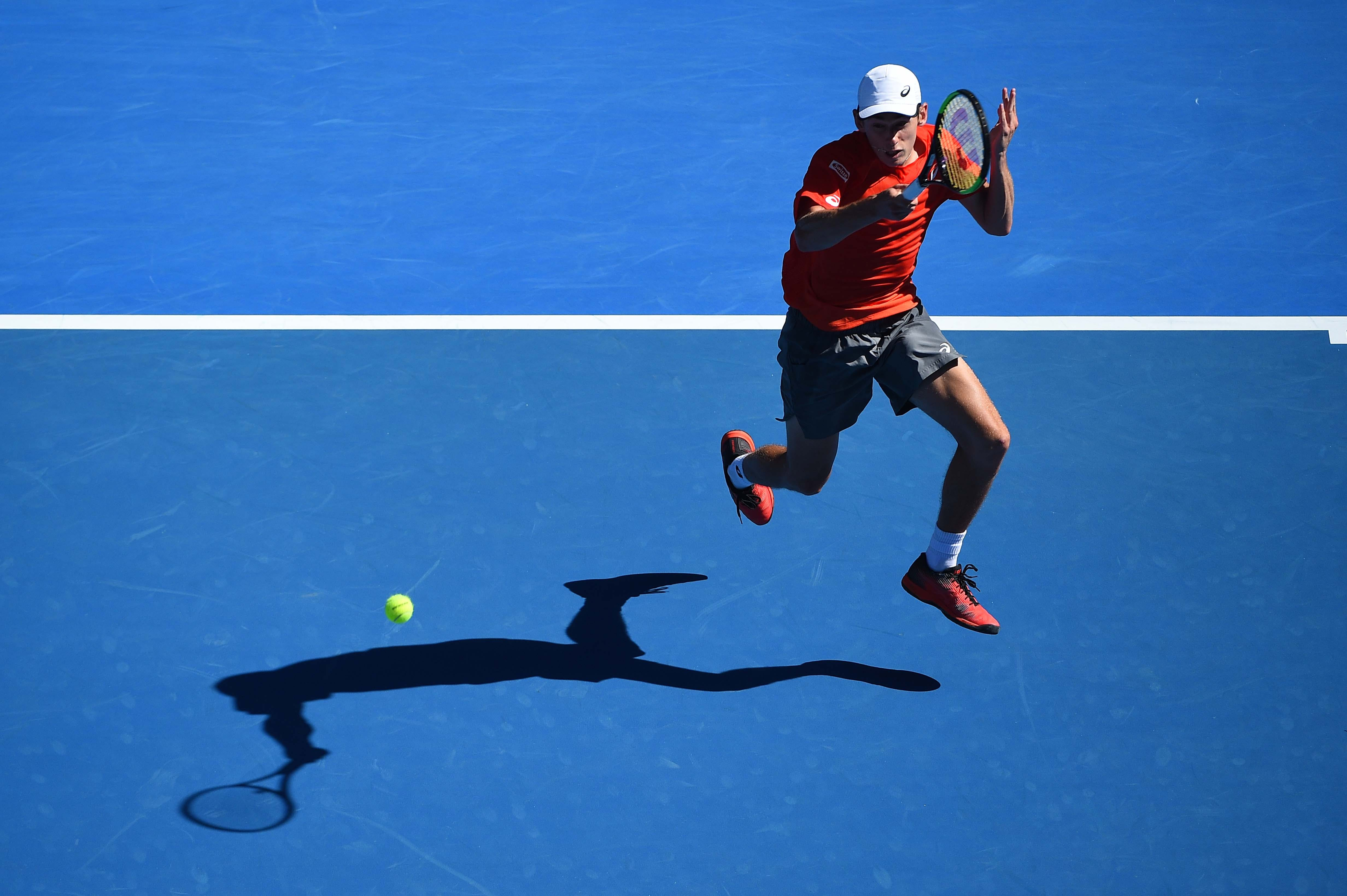 Alex de Minaur jumping during his second round match at the 2019 Australian Open