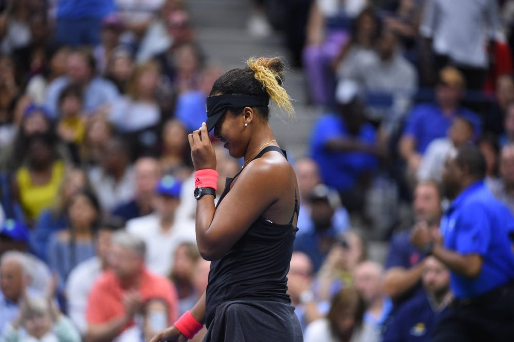Naomi Osaka hiding behind her cap US Open 2018