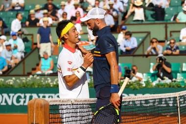 Kei Nishikori (L) and Benoit Paire