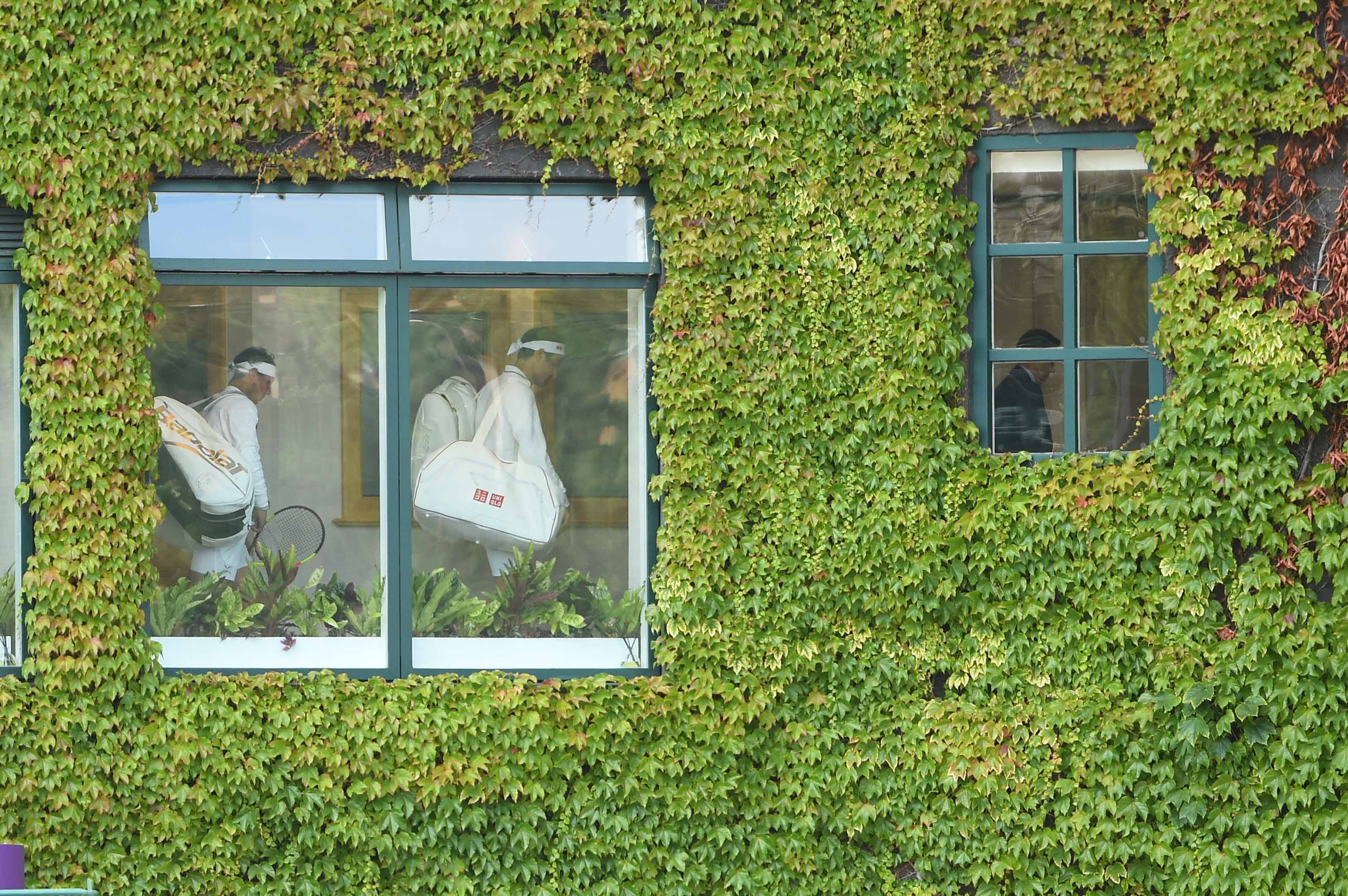 Roger Federer and Rafael Nadal through the window of the Centre Court at Wimbledon 2019