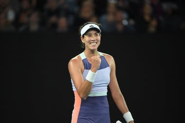 Garbiñe Muguruza smiling and fist pumping during 2020 Australian Open.