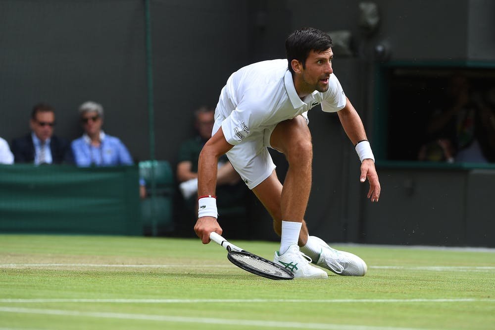 Novak Djokovic almost dancing and sliding on the grass at Wimbledon 2019