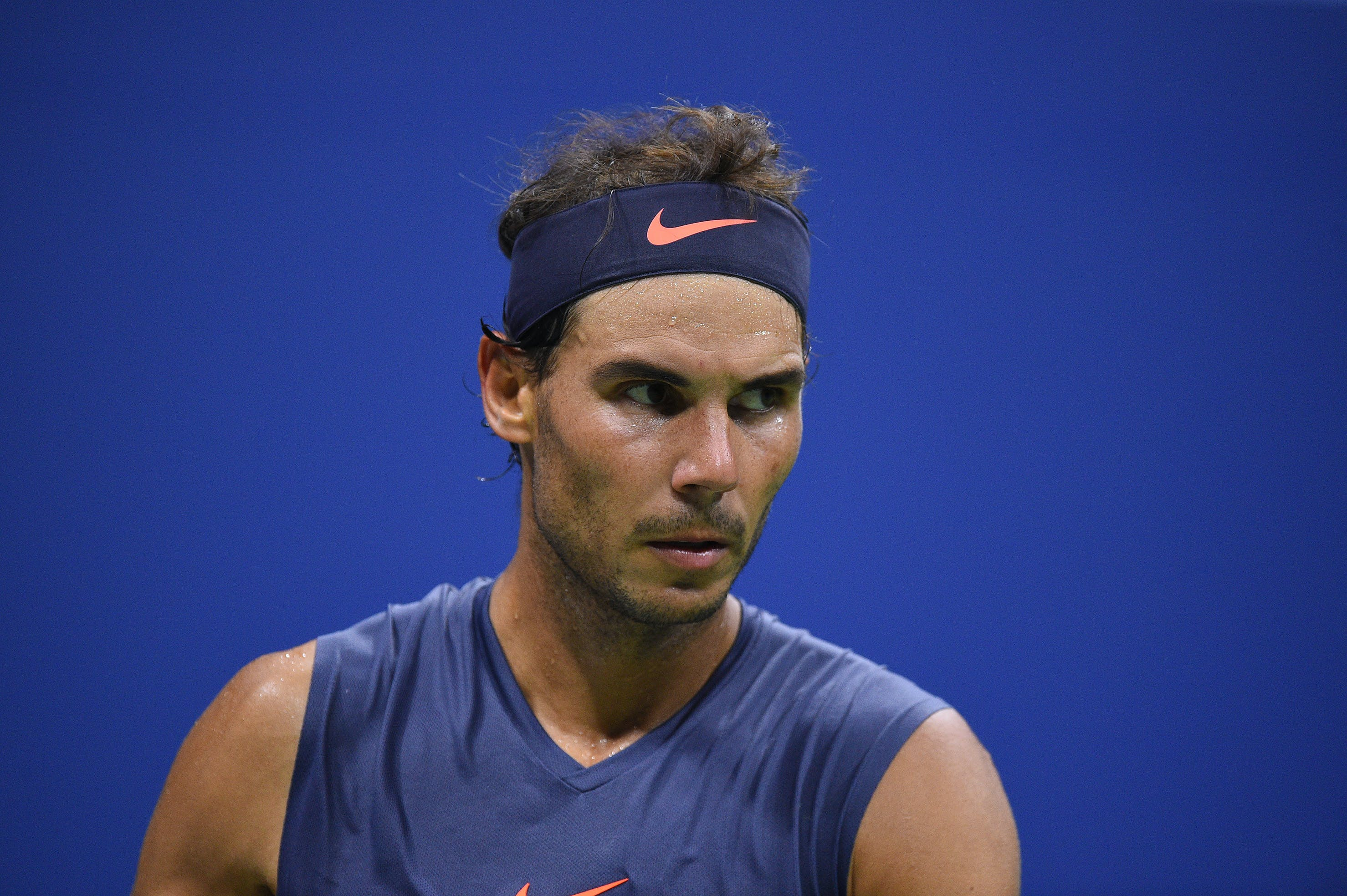 Rafael Nadal sweating and lokking US Open 2018