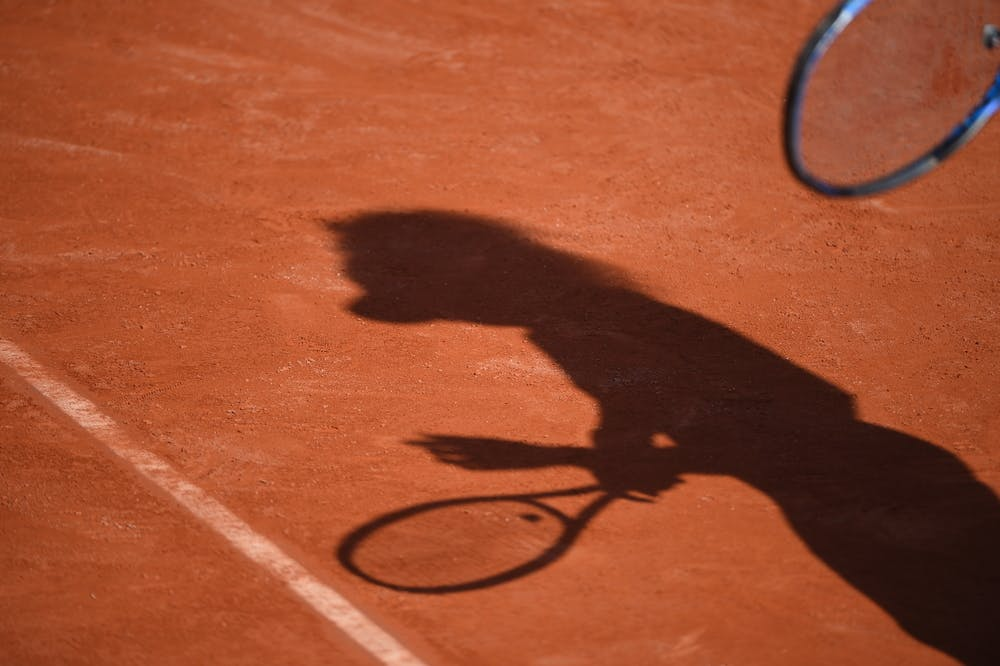 Player's shadow on the clay of Roland-Garros 2019
