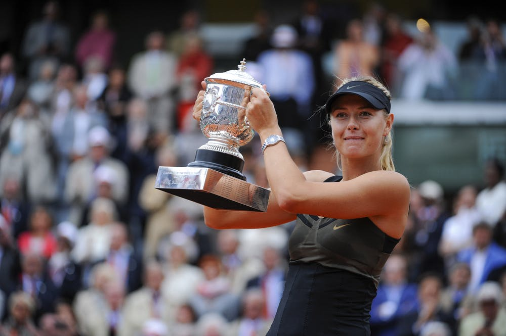 Maria Sharapova posing with her first Roland-Garros trophy in 2012