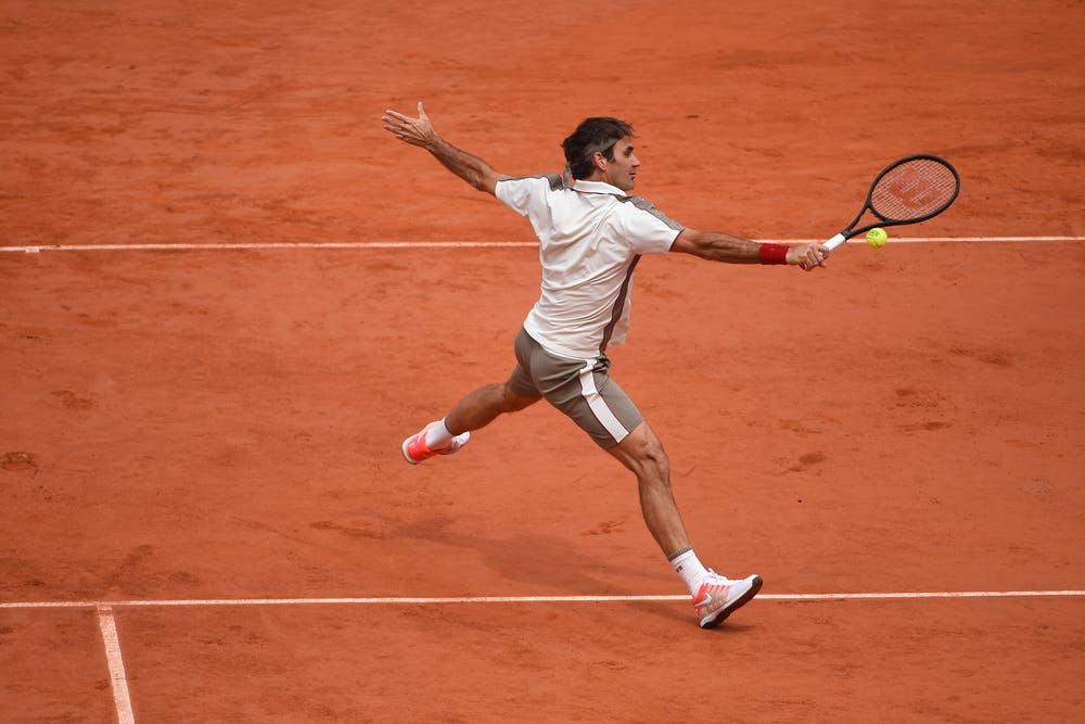 Roger Federer hitting a volley at Roland-Garros 2019