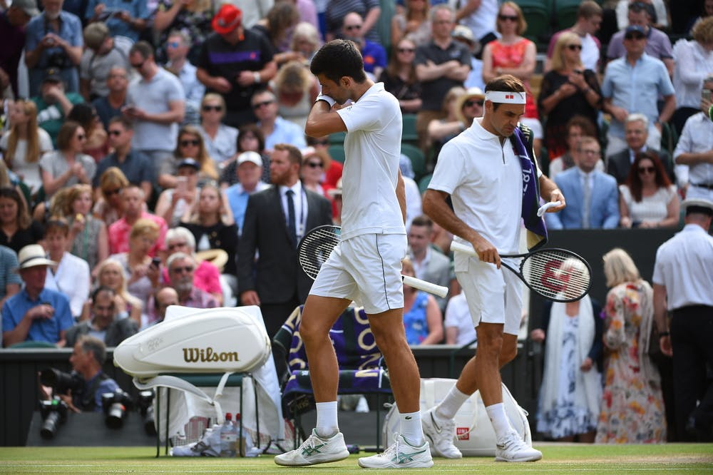 Novak Djokovic and Roger Federer changing ends during the Wimbledon 2019 final