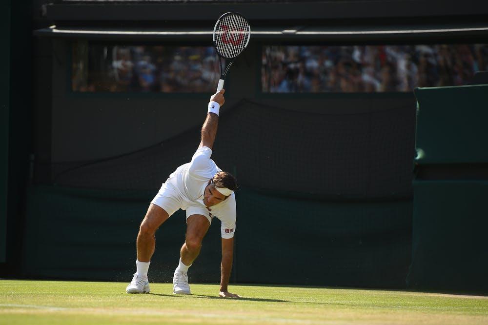 Roger Federer sliding on the grass of Wimbledon 2018