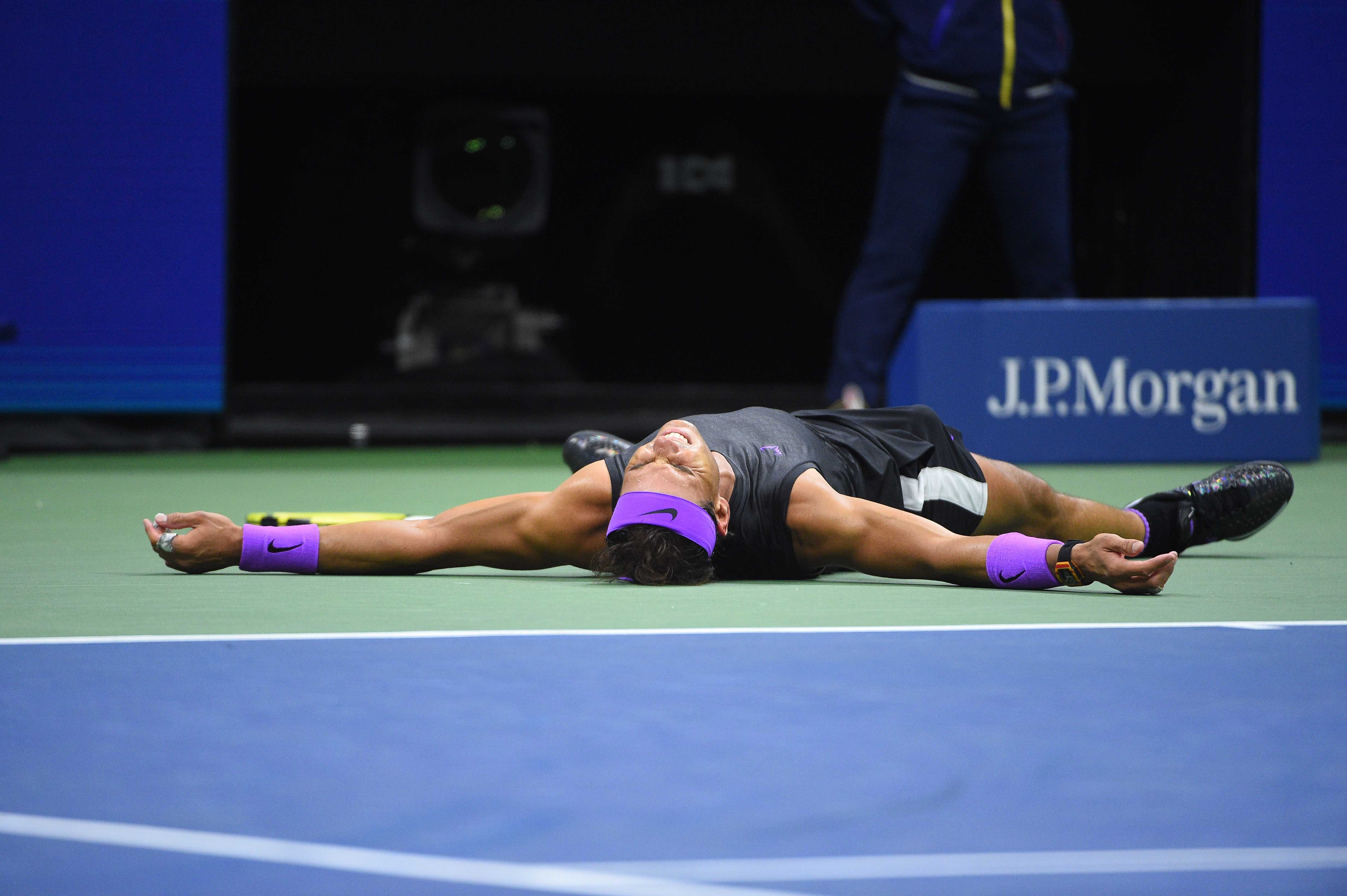 Rafael Nadal falling to the ground as he just won the 2019 US Open