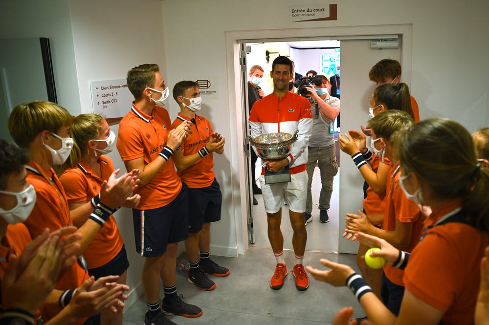 Novak Djokovic in the locker room with ballkids right after his win at Roland-Garros 2021