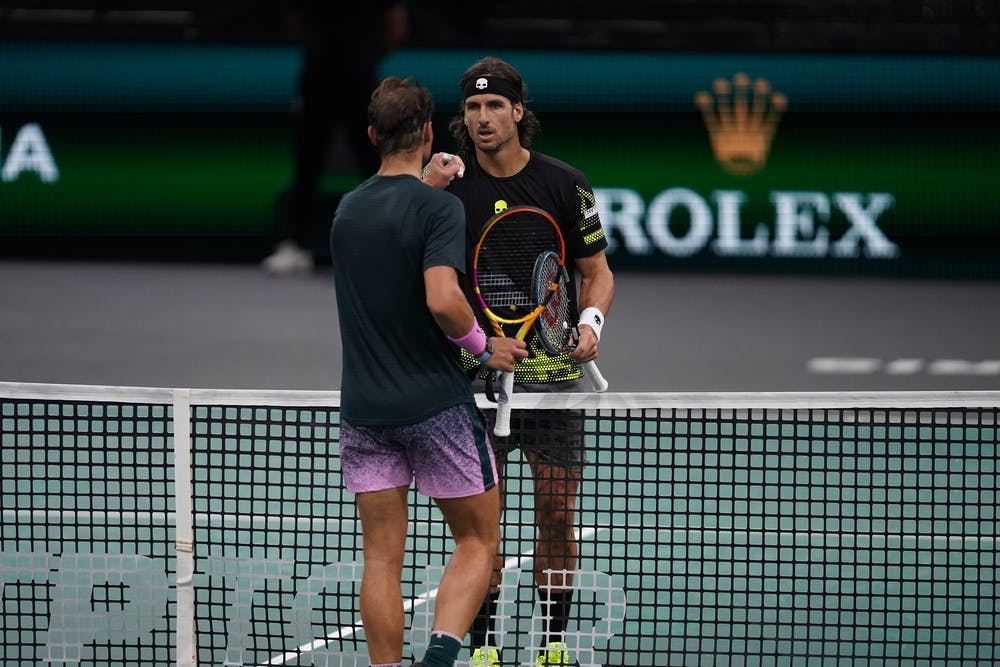 Feliciano Lopez and Rafael Nadal at the net at the Rolex Paris Masters 2020