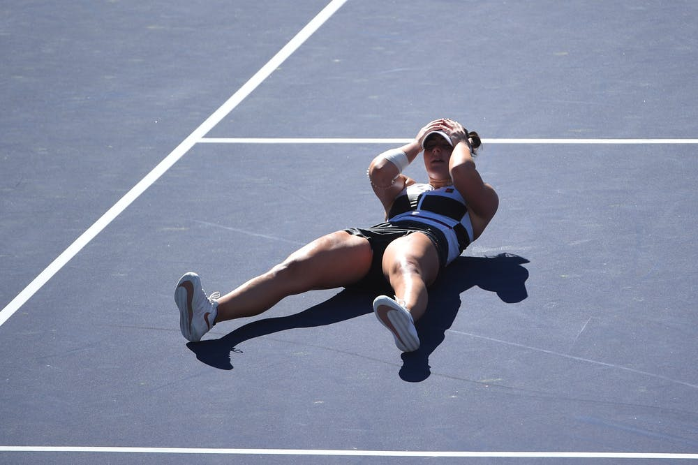 Bianca Andreescu lying on the ground after match point in the final of Indian Wells 2019