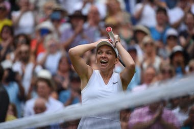 Simona Halep smiling of joy while realizing she just won Wimbledon 2019