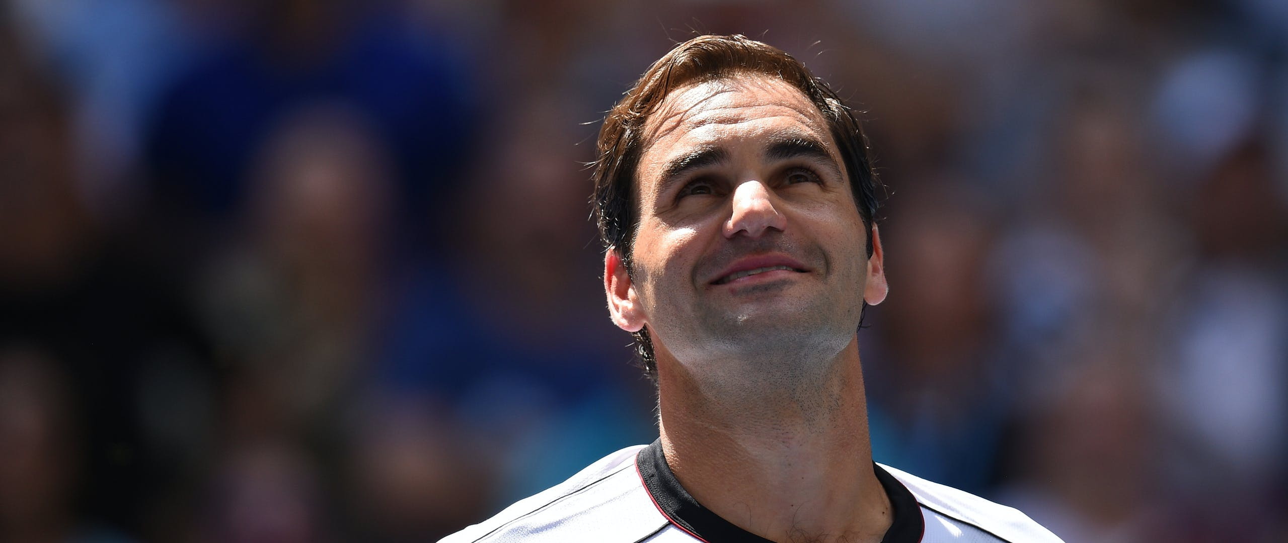 Roger Federer with a large smile on his face