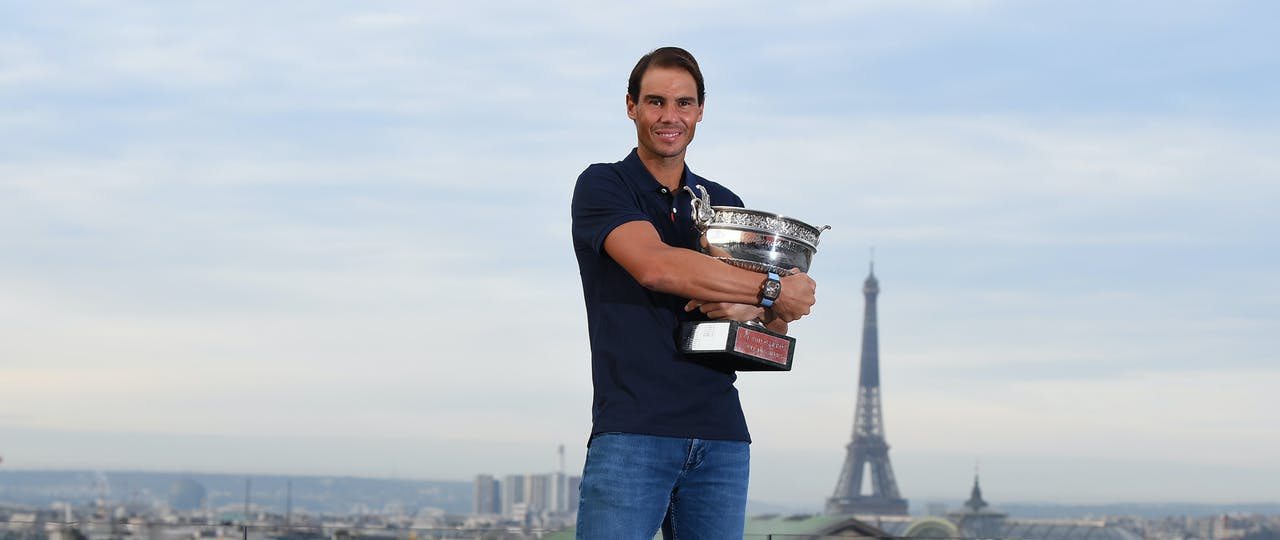 Rafael Nadal poses with his 13th Roland-Garros trophy on the rooftop of Les Galeries Lafayette, October 2020