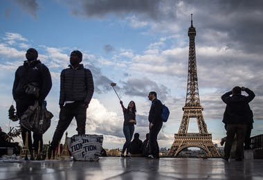 Tourists at the Eiffel Tower in Paris.